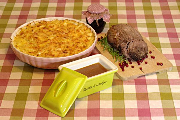 Serveringsförslag med aroniagelé, potatisgratäng och tjälknöl